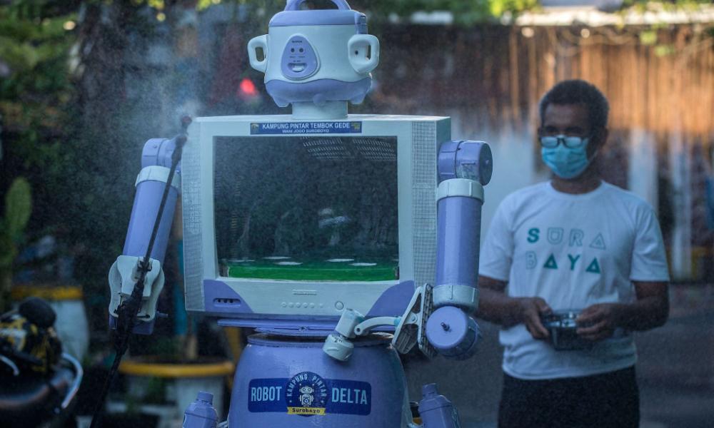 Malaysiakini - Indonesian village turns unwanted trash into Covid-19 robot helper